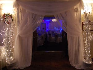 Trees and white fabric entrance into the Winter Wonderland