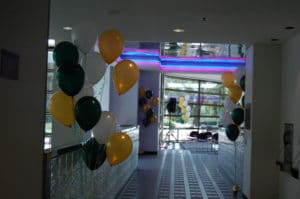 Bouquets of yellow green white balloons corporate events