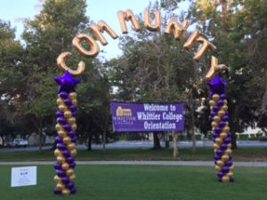 Purple and gold Whittier College columns arch community corporate event outdoor
