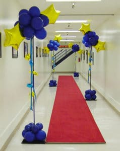 Star columns blue gold red carpet entrance corporate event