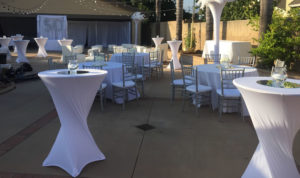 All white Miami nights party outdoors tables chairs linens feather trees 50th